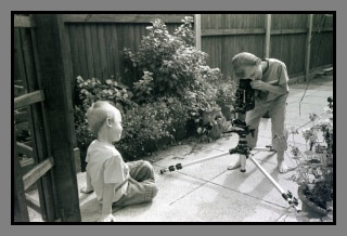 ryan and liam playing in the garden with mamiya c330f